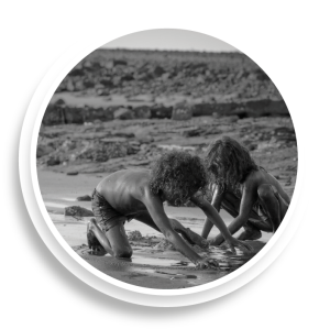 two children digging on mudflats