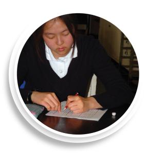 schoolgirl writing on paper